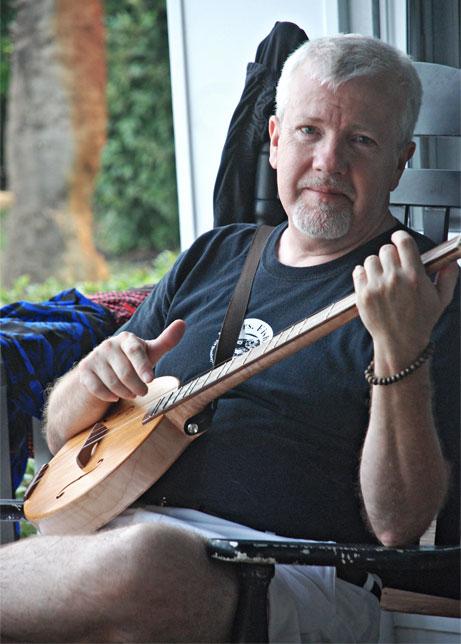 Robert Hudson playing a musical instrument